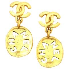 Chanel Logo Cutout Dangling Earrings