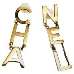 CHANEL Long CHA NEL Earrings - Gold