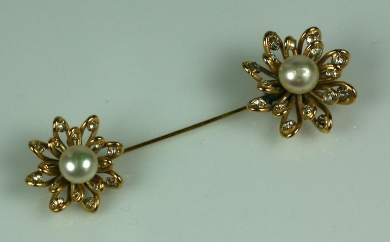Lovely jabot brooch by Maison Goossens for Chanel. Looped gilt wires free form the flowerheads which are studded with pastes and hand made  nacre faux pearl  cabocheon centers.  3.75
