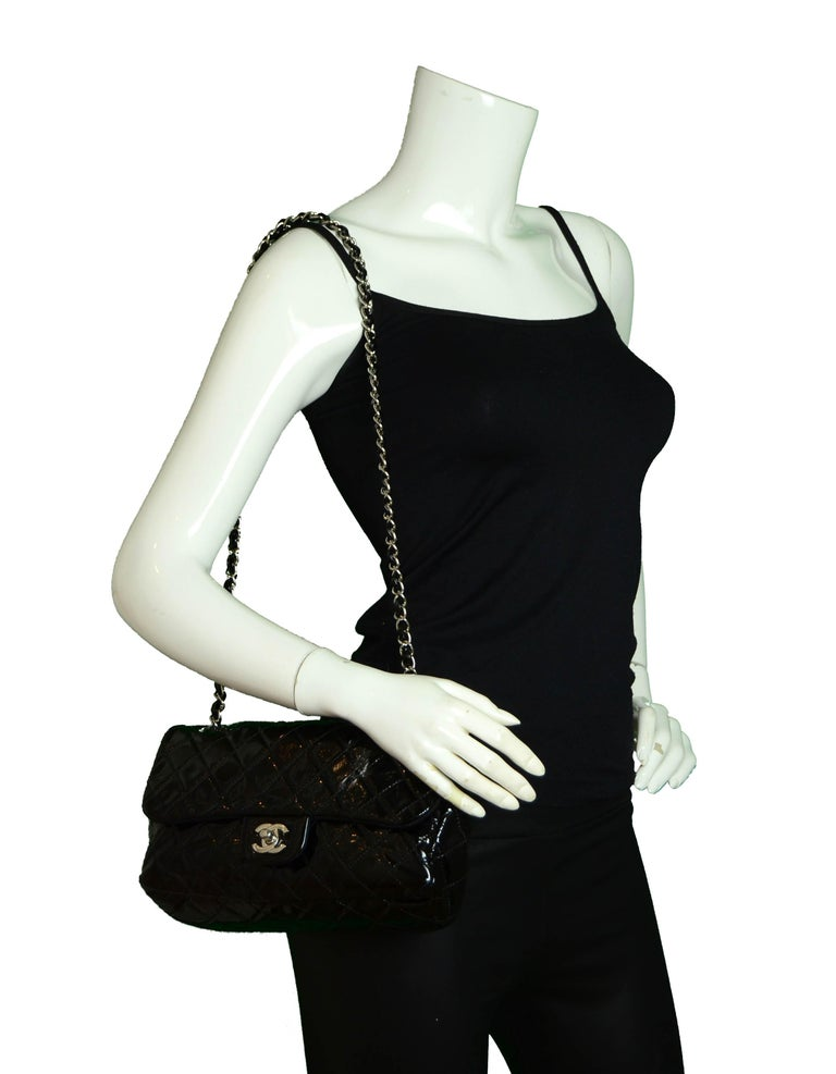 Chanel Ltd Edition Black Mesh & Patent La Madrague 2 in 1 Tote/Flap Bag.  Features removable Chanel black patent leather classic quilted flap bag that can be worn on its own, or attached to the tote bag.  Great for a day to night look.  Made In: