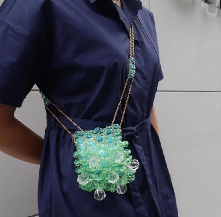 A Chanel Bag to Forever Shine.  This beautifully beaded Chanel bag is the ultimate evening bag.  Produced by Chanel in limited quantities, it is the ideal addition to a serious Chanel collection. Featuring green and blue lucite beads intricately