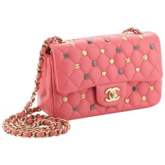 Chanel Lucky Charm mini classic. Pink Leather and multi-color lucky charm.