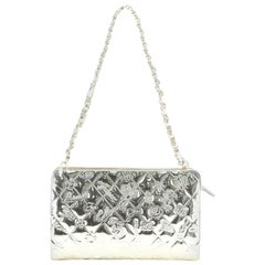 Chanel Lucky Symbols Pochette Embossed Quilted Patent