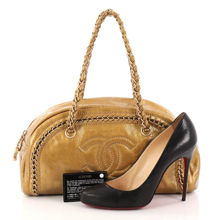 This Authentic Chanel Luxe Ligne Bowler Bag Patent Medium Showcases An Edgy Eal And Playful Sporty