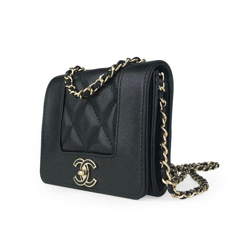 Black quilted lambskin Chanel Mademoiselle Wallet on Chain with  - Gold-tone hardware - Single chain-link and leather shoulder strap - CC logo adornment at front - Black interior, 3 interior pockets pockets and snap closure at front flap  Overall