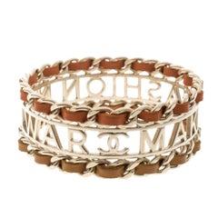 Chanel Make Fashion Not War Orange Leather Gold Tone Wide Bangle Bracelet 20cm