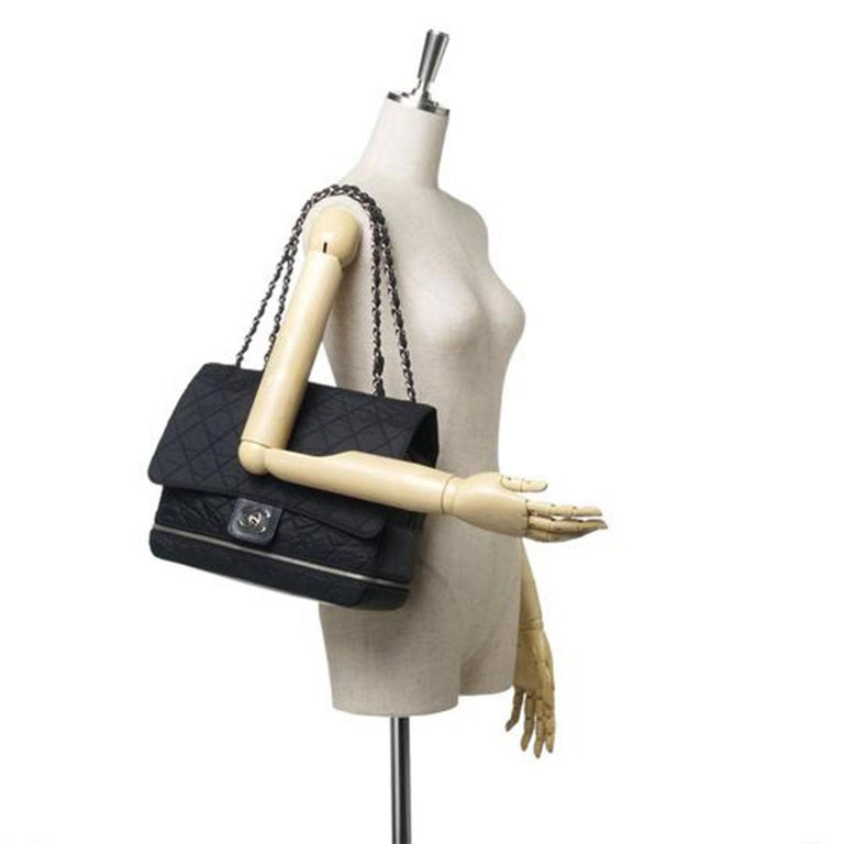 This shoulder bag features a nylon body, silver-tone chain straps, zip around detail, front flap with interlocking CC twist lock closure, top zip closure, exterior slip pocket and interior zip pocket.   Inclusions:  Dust Bag Authenticity