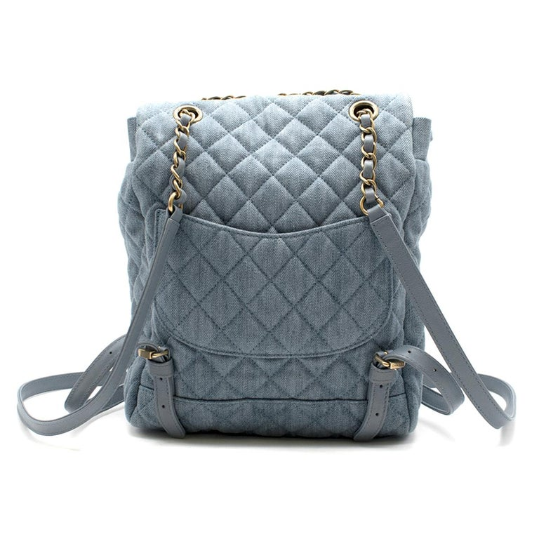 Chanel Matrasse Coco Mark denim backpack  - Light-blue, quilted denim - Antiqued gold-tone metal hardware  - Chain and blue leather top handle, adjustable blue leather shoulder straps  - Back slip pocket  - Front flap, signature CC plaque and