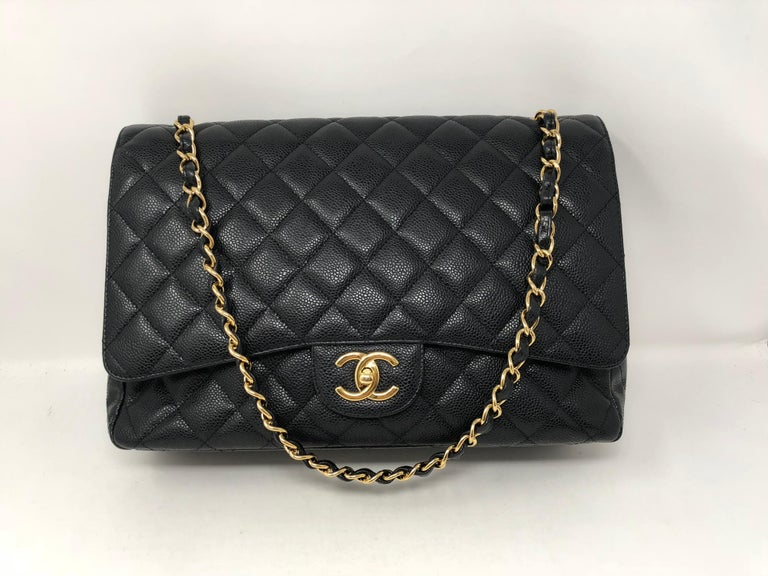 Chanel Black Maxi Caviar leather with gold hardware. Pristine mint condition. Black caviar leather is very durable and highly sought after. This is the largest size of the Classics. Double Flap. Guaranteed authentic. Don't miss out on this one!
