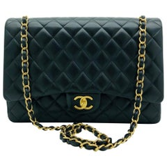 Chanel Maxi Classic Flap Bag - Black Lambskin Gold Hardware