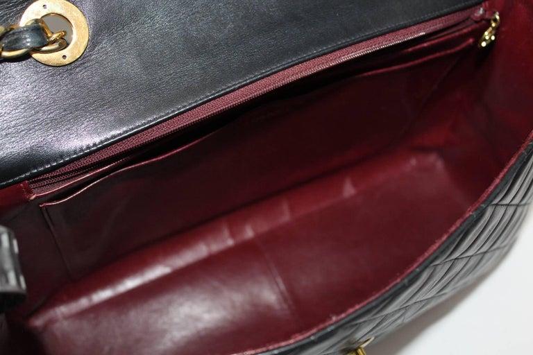 Women's Chanel Maxi Jumbo Single Flap Gold Hardware Black Lambskin  For Sale