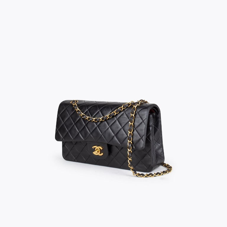 Black quilted lambskin Chanel Medium Classic/Timeless Double Flap bag with  – Gold-tone hardware – Convertible chain-link and leather shoulder strap – Burgundy leather lining – Single patch pocket at back – Single zip pocket at flap underside, three