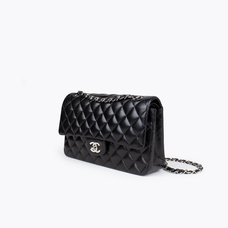 Black quilted lambskin Chanel Medium Classic/Timeless Double Flap bag with  – Silver-tone hardware – Convertible chain-link and leather shoulder strap – Burgundy leather lining – Single patch pocket at back – Single zip pocket at flap underside,