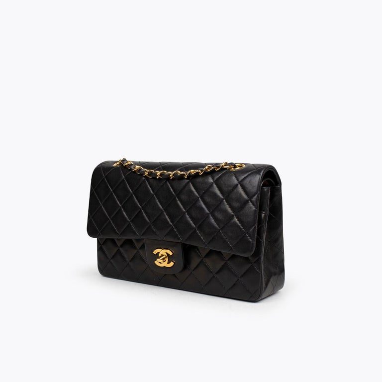 Black quilted lambskin Chanel Medium Classic Double Flap bag with  – Gold-tone hardware – Convertible chain-link and leather shoulder strap – Burgundy leather lining – Single patch pocket at back – Single zip pocket at flap underside, three