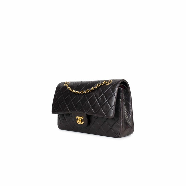 Dark Brown quilted lambskin Chanel Medium Classic Double Flap bag with  – Gold-tone hardware – Convertible chain-link and leather shoulder strap – Burgundy leather lining – Single patch pocket at back – Single zip pocket at flap underside, three