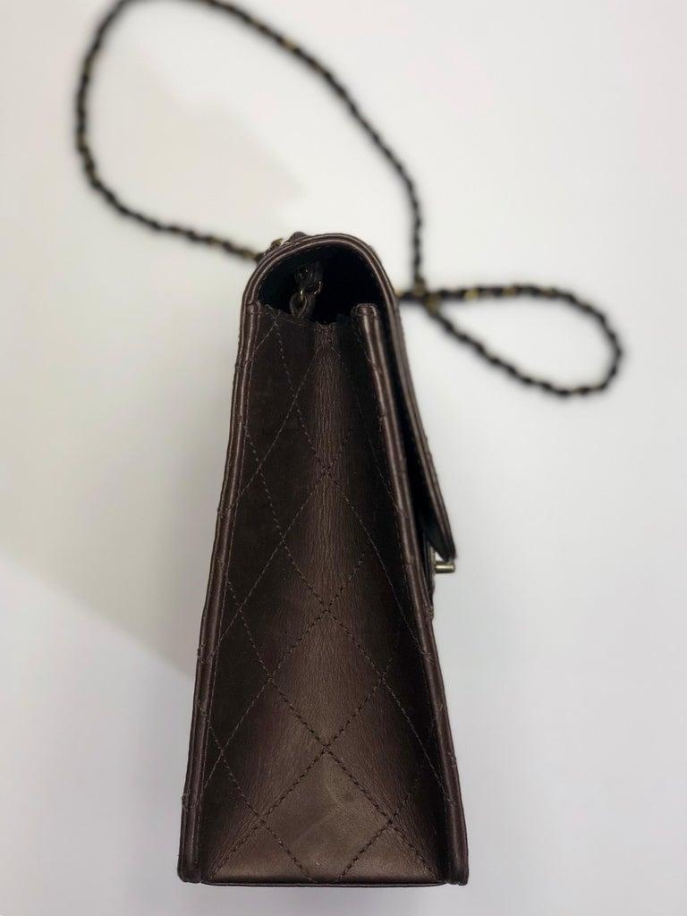 Chanel Chocolate Brown, Lambskin, Medium Classic Single Flap Shoulder Bag w/ Chainlink Strap & Twist-Lock Closure.