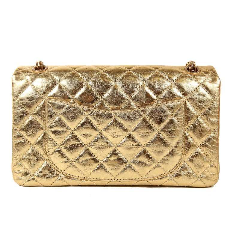 Chanel Metallic Gold Leather Reissue Flap Bag- PRISTINE; appears never carried.  The updated classic is stunning in show stopping metallic gold foil. Gold foiled leather is quilted in signature Chanel diamond pattern with an intentionally crinkled