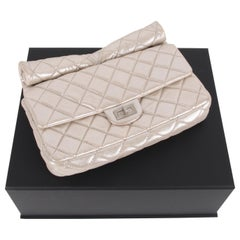 Chanel Metallic Gold Quilted Roll Leather Clutch