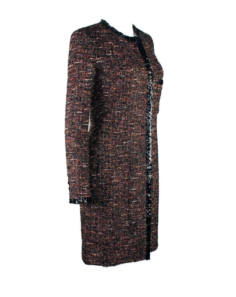 Beautiful CHANEL fantasy tweed jacket designed by Karl Lagerfeld A true CHANEL signature item that will last you for many years Closes in front with concealed