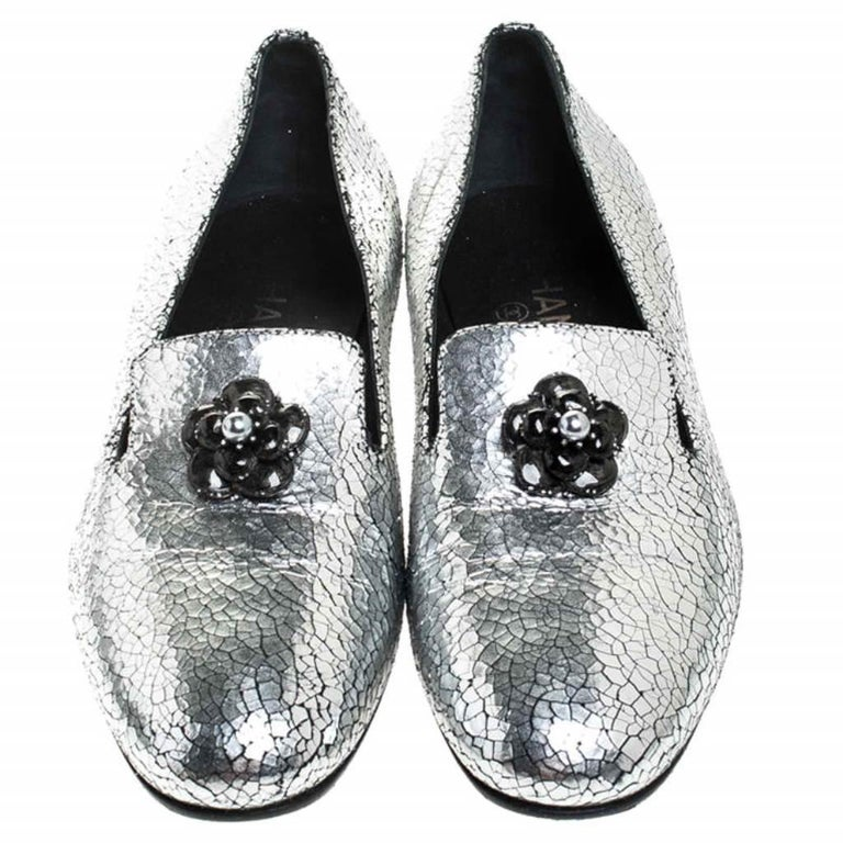 The house of Chanel brings you these impressive metallic flats to complement any outfit. Chic and durable, these textured leather flats will be a memorable purchase. They feature round toes and the signature Camellia flower on the uppers.  Includes:
