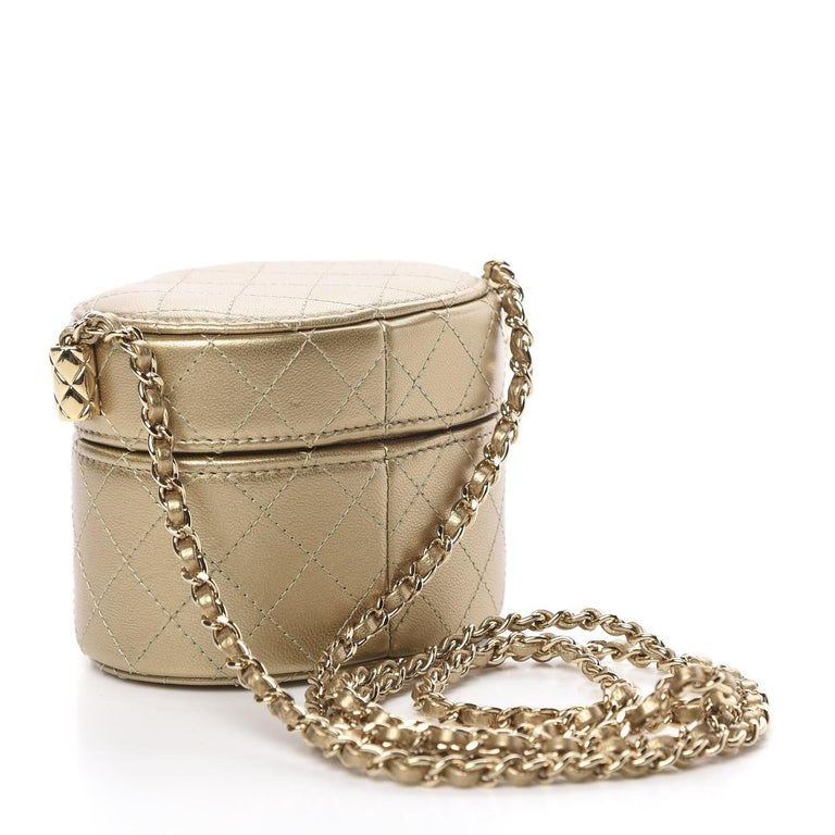 Chanel Micro Mini Gold Quilted Lambskin Leather Jewelry Box Crossbody Bag  Lambskin leather Gold Leather interwoven chain strap Top lid opening with magnetic snap closure Gold tone hardware Fabric lining Mirror on lid Measurements: 4