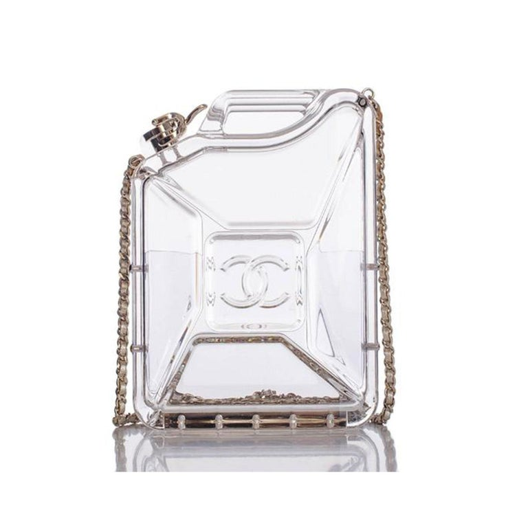 Stunning unique Chanel Dubai jerry can minaudière fashioned as a gas tank.  This unique transparent bag can be worn as a crossbody or clutch with the chains tucked in. Clear design with CC logo stamp, functioning gas tank clasp, and classic