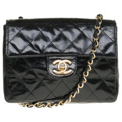 Chanel Mini square handbag in black quilted patent leather, gold hardware
