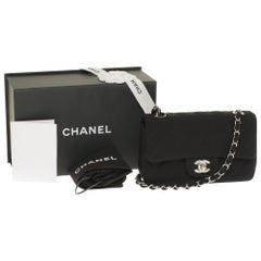 Chanel Mini Timeless handbag in black quilted Tweed and silver hardware