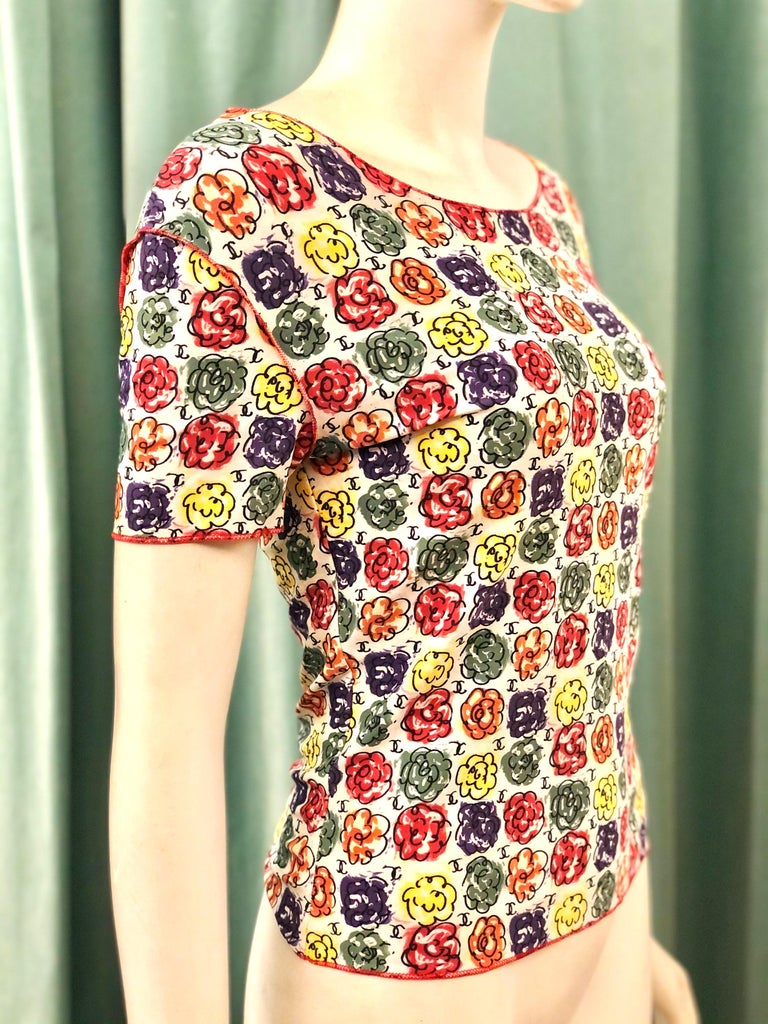 - Vintage Chanel multi-coloured floral print t shirt from 2000s collection.   - Decorated with an all-over floral pattern short sleeves.   - Nylon 80%, Spandex/Elastane 20%.   - Size 38.