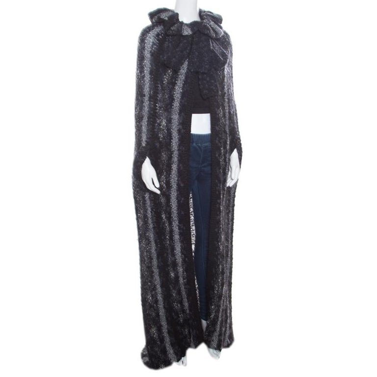 This Chanel cardigan is a versatile creation that definitely deserves a place in your wardrobe! It is made of a wool blend and features a chunky knit design. It flaunts an open front cape-style silhouette and wide collars with a tie detailing. Pair