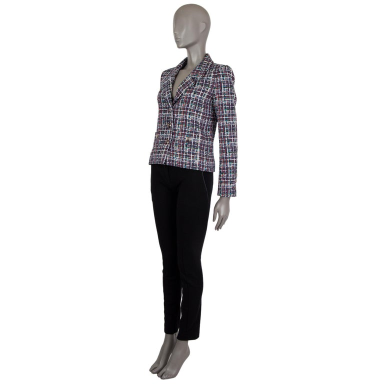 Chanel plaid-tweed blazer in navy, white, red, cyan, green, black, beige,  and rust cotton (56%), silk (28%), and nylon (16%). With notch collar, three-button sleeves, two buttoned patch pockets on the front sides, and signature weight chain around