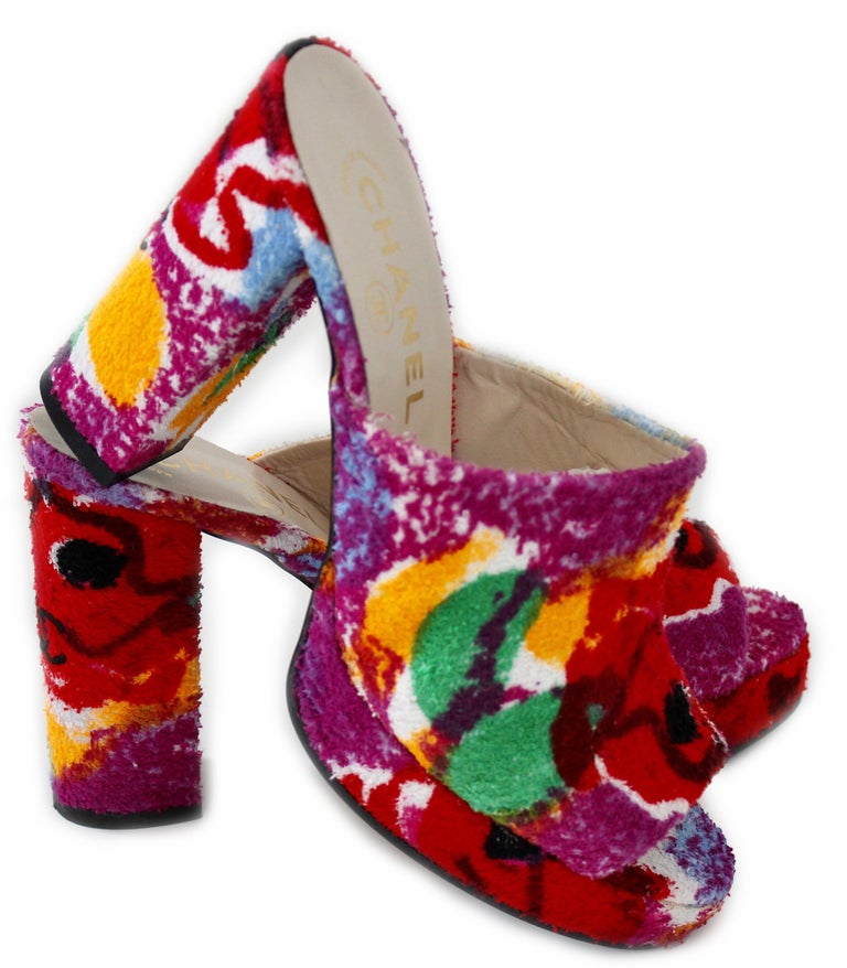 Here's a fabulous pair of platform heels from Chanel, most likely made in the 1990s.  Made from a vibrant floral terry cloth fabric, they feature 4.25in H block heels with leather uppers and soles.  Note that these are new old stock, never worn and