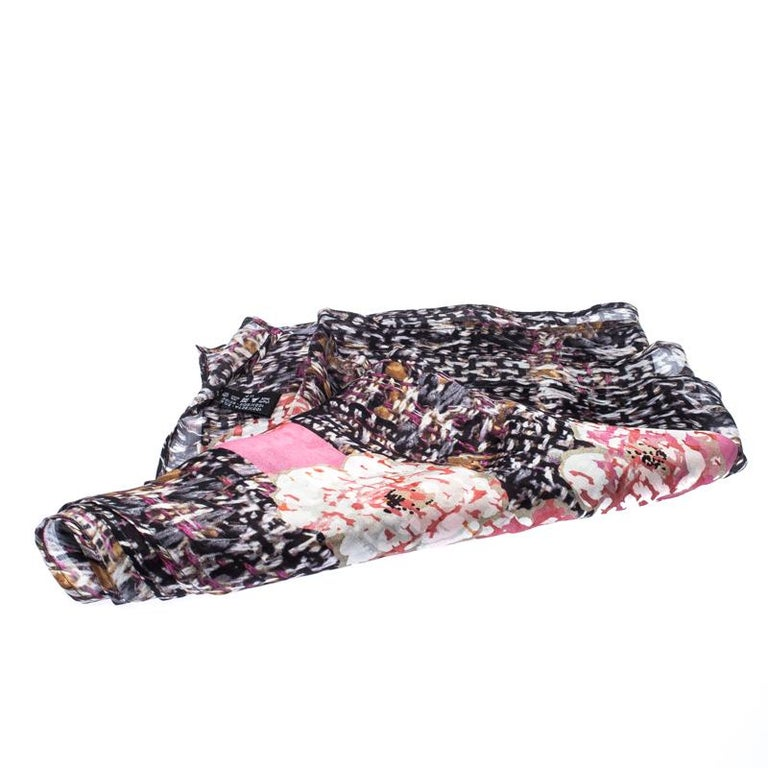 Beautifully cut from silk, this Chanel scarf features gorgeous floral prints in varied colours all over. It is finished with hemmed edges. Make this gorgeous scarf yours today, and flaunt it like a fashionista!  Includes: The Luxury Closet