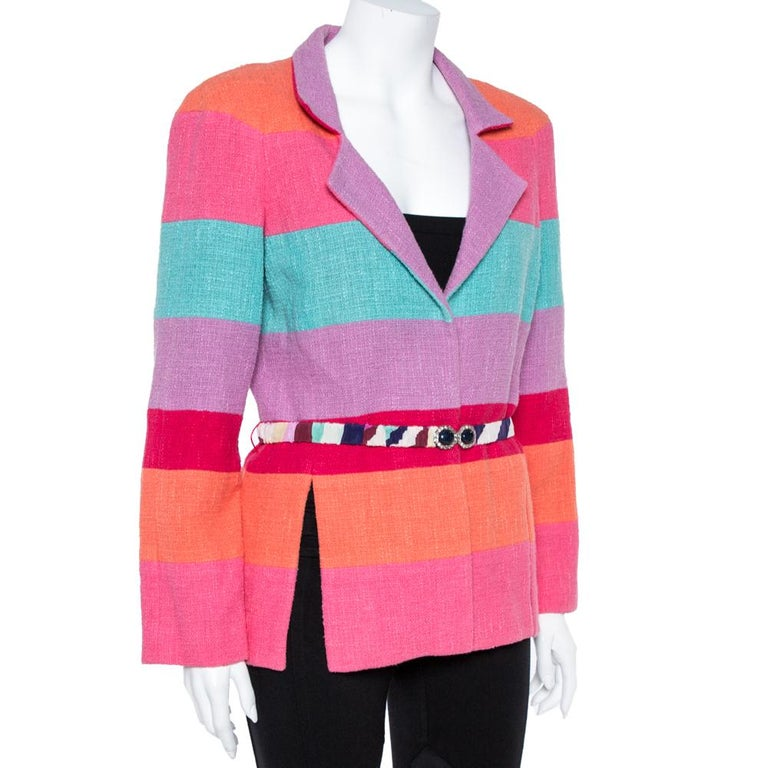 Fashioned in a contemporary design, this blazer from Chanel is a must-have! It is made of a cotton blend and styled with multicolor stripes. It flaunts notched lapels, a studded belt on the waist, and long sleeves. It is equipped with two vents and
