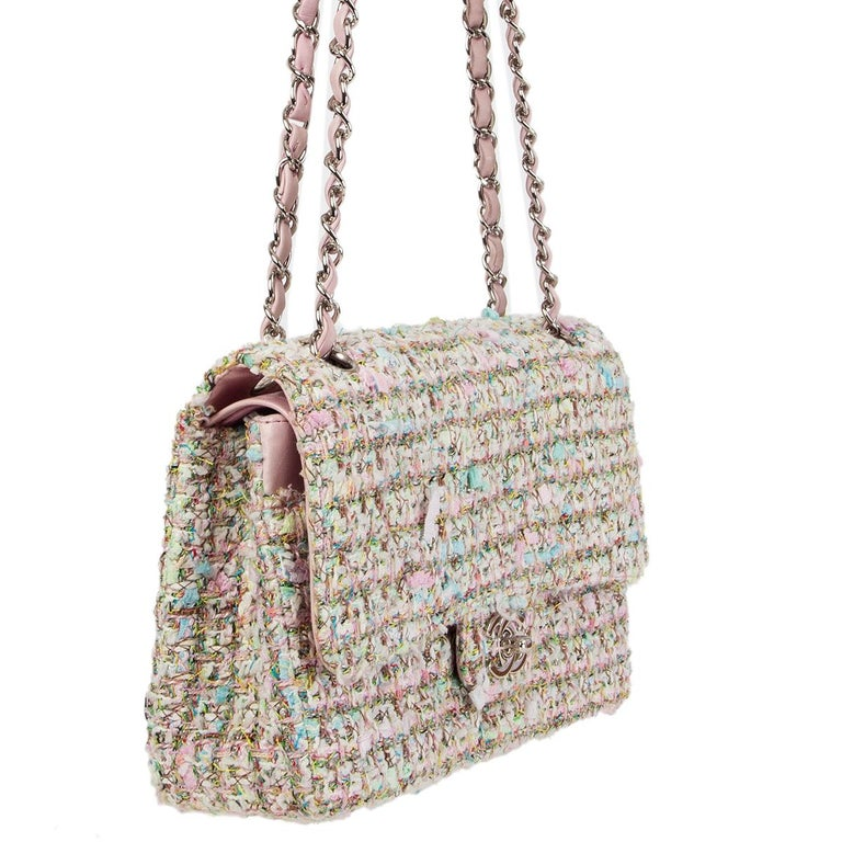 Chanel 'Timeless Classic Medium' flap bag in pink, pistachio green and mutlicolor boucle tweed. Open pocket on the outside back and on the front under the flap. Zip pocket in the flap. Lined in baby pink leather with two open and a lipstick pocket