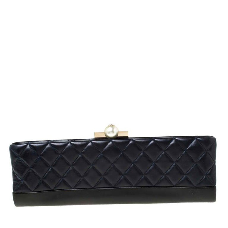 This Baguette Minaudiere clutch from Chanel is just what you need to grab all the attention at parties. This petite beauty features the signature quilted pattern on the exterior. Part of the Chanel spring 2014 pre-collection, the clutch comes with a