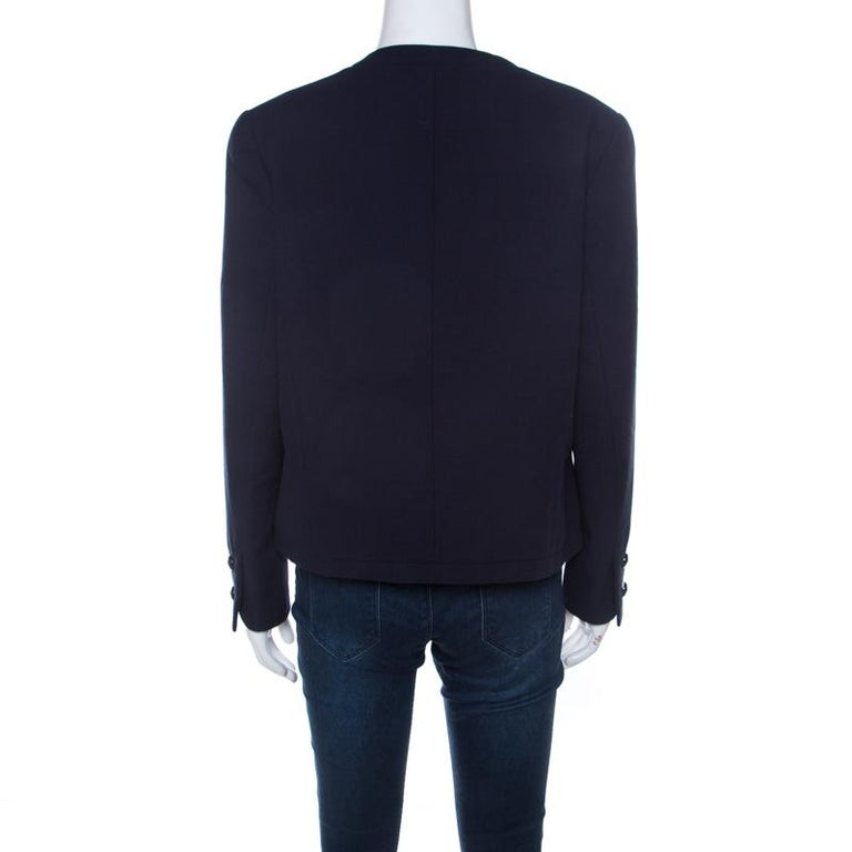 Picked from Chanel's prized collection of clothes is this gorgeous jacket that delights our sight with its colour and simple shape. The jacket arrives in navy blue with buttons on the long sleeves, an open front and textures all over.  Includes: The