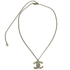 CHANEL Necklace Chain in gilded Metal and CC Pendant set with Brilliants