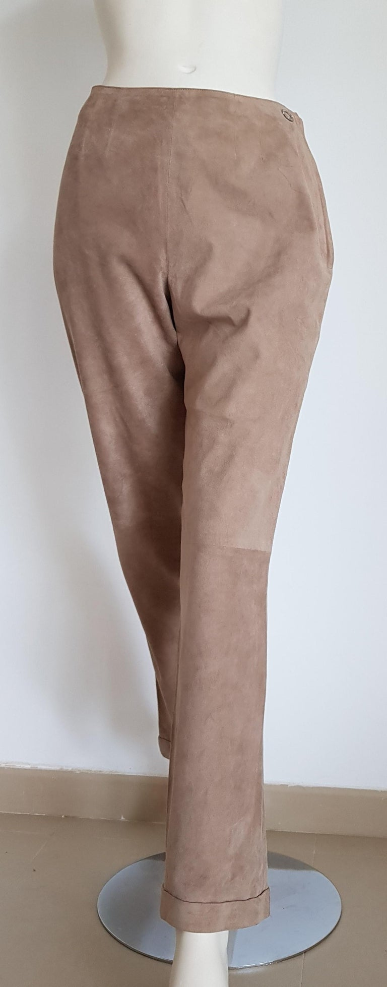 CHANEL beige suede pants silk lined - Unworn, New.  SIZE: equivalent to about Small / Medium, please review approx measurements as follows in cm. PANTS: lenght 99, inseam length 72, waist circumference 75, hip circumference 96, leg hem circumference