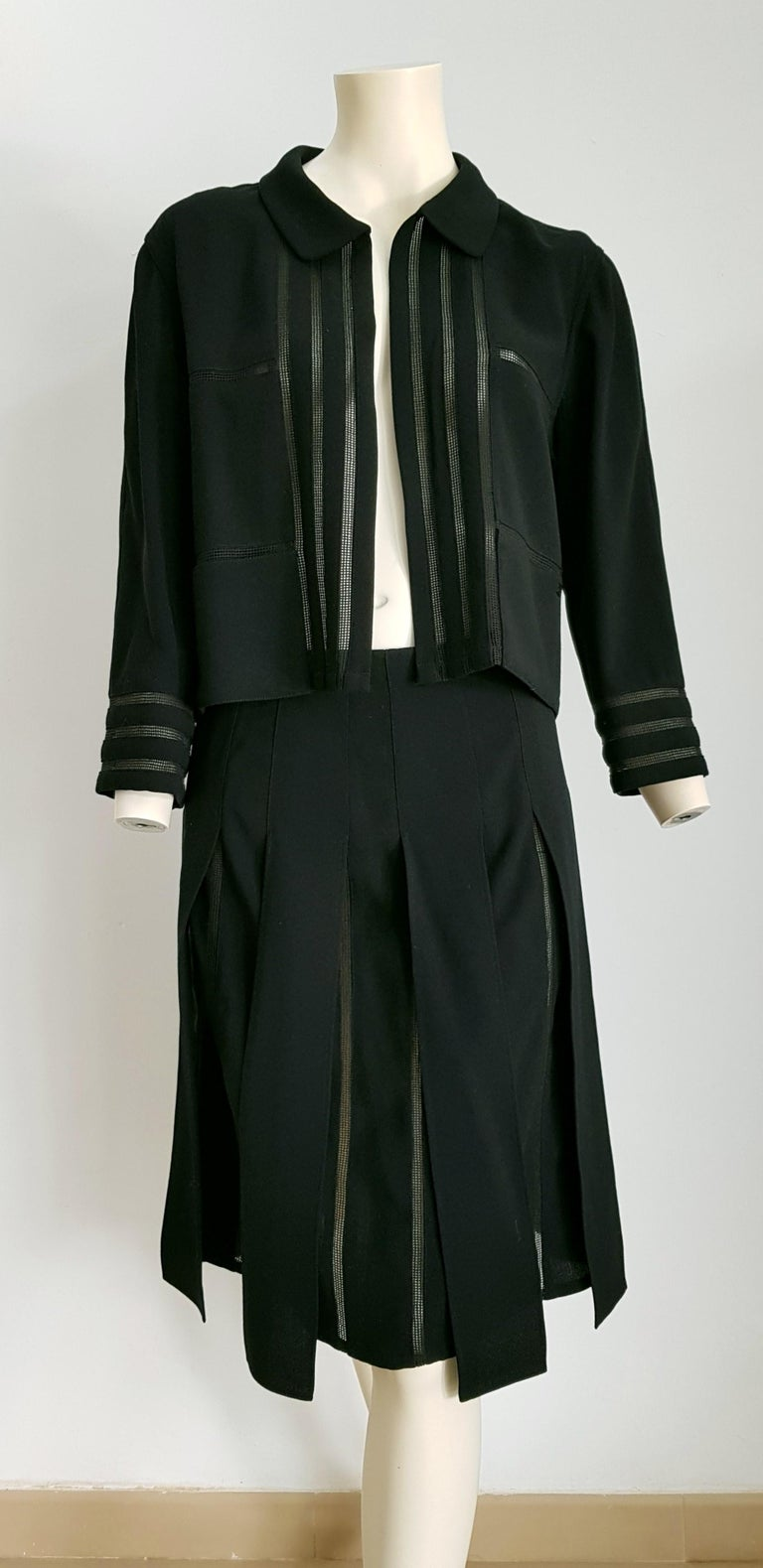 CHANEL black with transparent stripes wool skirt suit - Unworn, New. .. SIZE: equivalent to about Small / Medium, please review approx measurements as follows in cm.  JACKET: lenght 54, chest underarm to underarm 55, bust circumference 84, shoulder