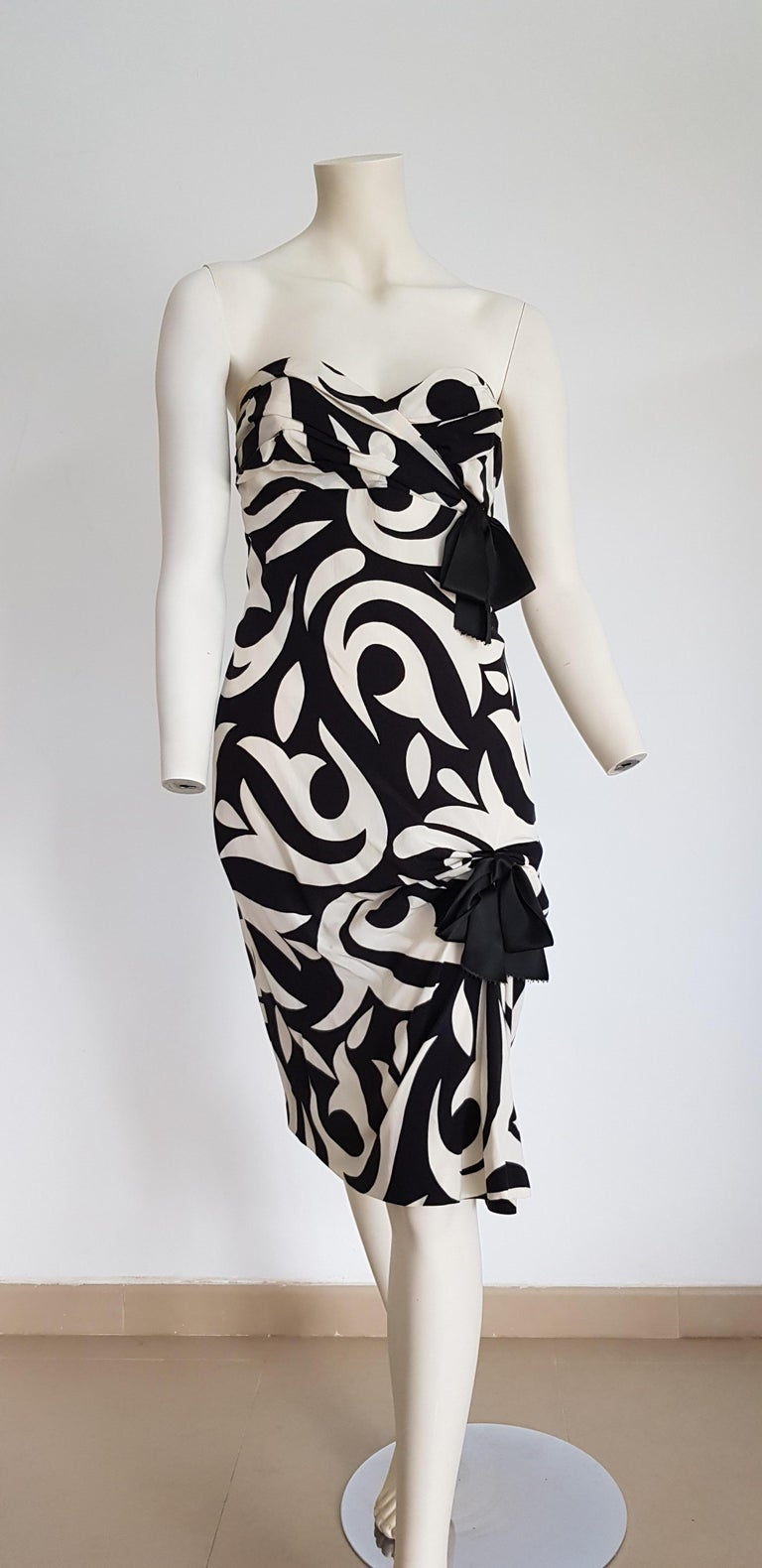 CHANEL Haute Couture, strapless, black with white lilies flowers design, two black bows on the front, silk, evening dress day dress - Unworn, New.  SIZE: equivalent to about Small / Medium, please review approx measurements as follows in cm: lenght