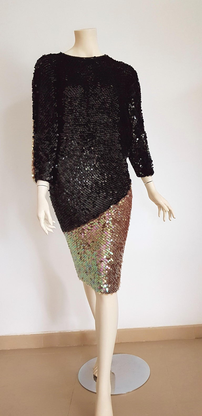 CHANEL Haute Couture covered with sequins on silk knit, black and pearl gown dress - Unworn, New.  SIZE: equivalent to about Small / Medium, please review approx measurements as follows in cm: lenght 101, chest elastic adjustable, bust elastic
