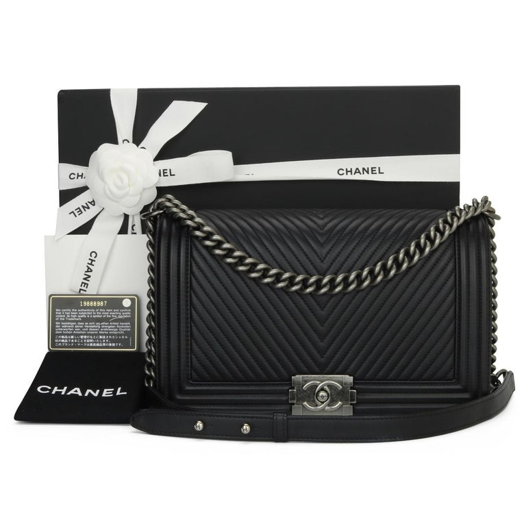 CHANEL New Medium Chevron Boy Bag Black Calfskin with Ruthenium Hardware 2014.  This stunning bag is still in excellent condition, the bag still holds its original shape and the hardware is still very clean and shiny.  - Exterior Condition: