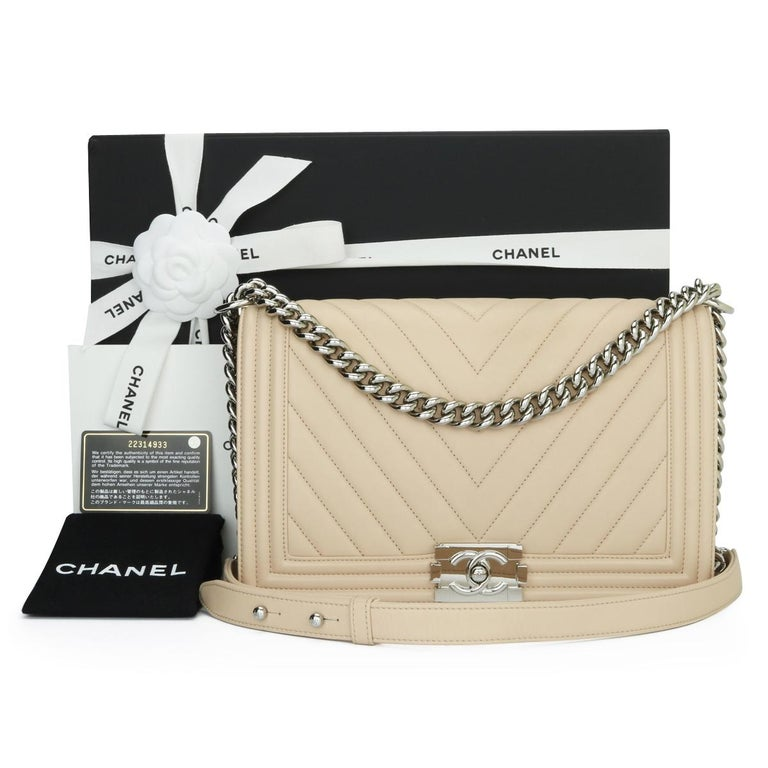 CHANEL New Medium Chevron Boy Bag Nude Calfskin with Silver Hardware 2016.  This stunning bag is still in excellent condition, the bag still holds its original shape and the hardware is still very clean and shiny.  - Exterior Condition: Excellent