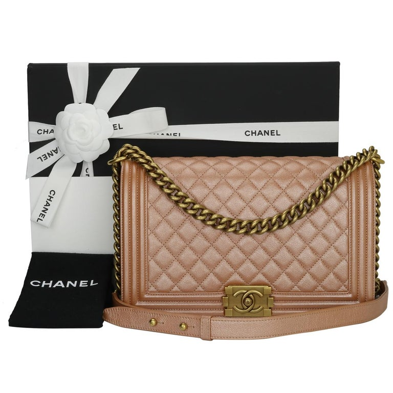 Authentic CHANEL New Medium Quilted Boy Bag Iridescent Pearly Rose Gold Calfskin with Antique Gold Hardware 2015.  This stunning bag is still in excellent condition; it still keeps its original shape and the hardware still very shiny.  Exterior