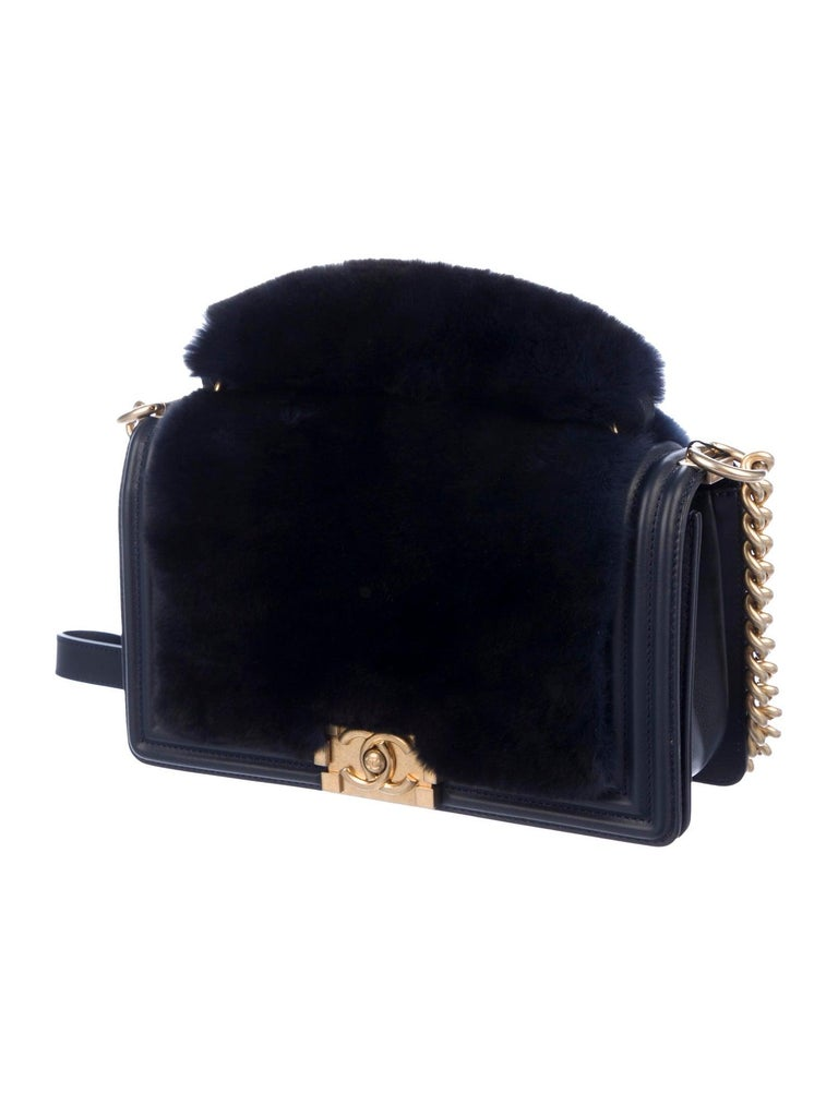 Leather Rabbit fur Gold-tone hardware Leather lining Push-lock closure  Made in Italy Date code present Shoulder drop 22