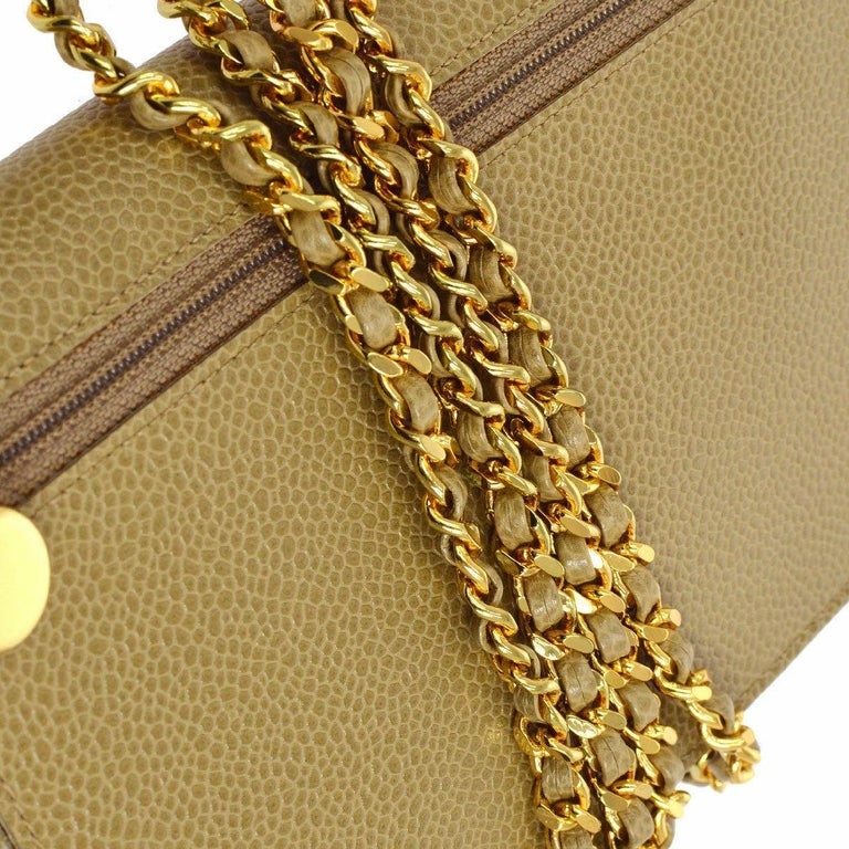Caviar leather Gold tone hardware Snap closure Woven lining Date code present Made in France Shoulder strap drop 24