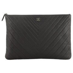 Chanel O Case Clutch Chevron Calfskin Large