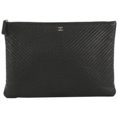 Chanel O Case Clutch Chevron Caviar Large, crafted from black c