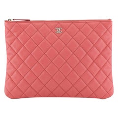 Chanel O Case Clutch Quilted Caviar Medium